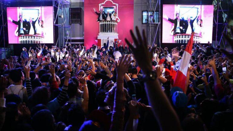 Exit polls show Kuczynski edged Fujimori in Peru's election